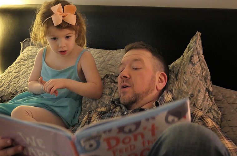 Noah Solomon reading aloud to daughter Anabel