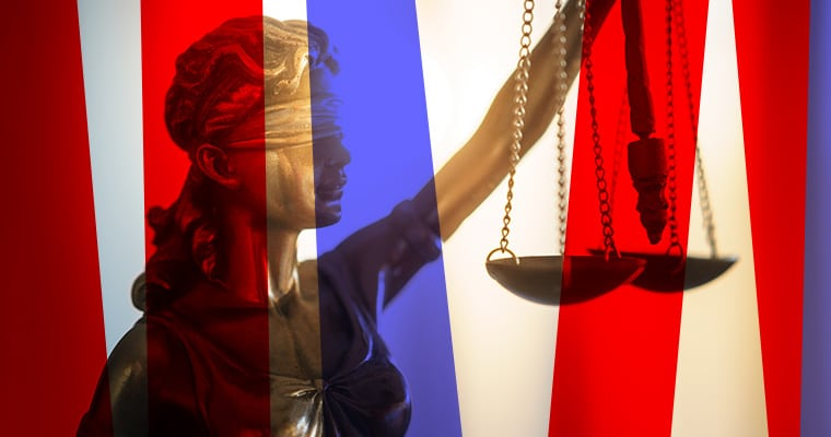 Lady Justice amidst red and blue